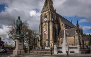 Bury Parish Church and statue of Sir Robert Peel.