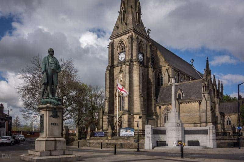 Bury Parish Church and statue of Sir Robert Peel.