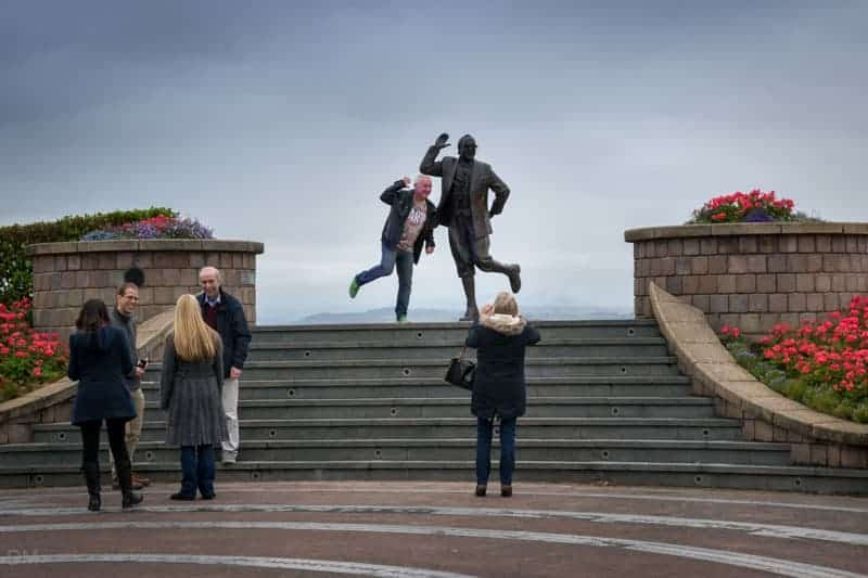 Posing for Photographs at the Eric Morecambe Statue in Morecambe, Lancashire