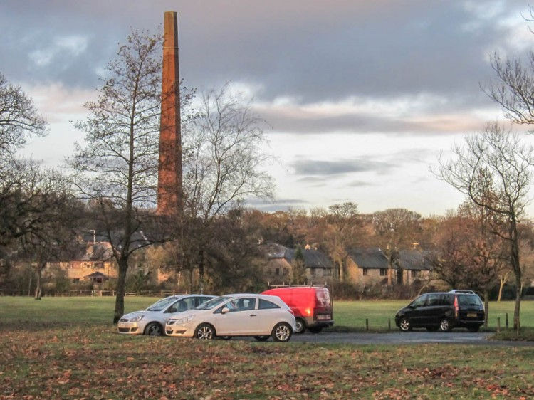 Car park at Moss Bank Park with Barrow Bridge Chimney in background