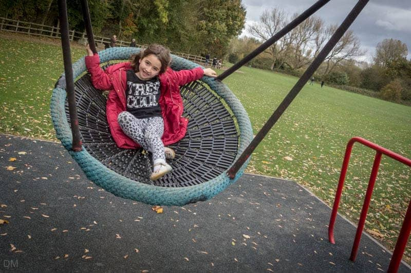 Girl on a swing at the playground at Pennington Flash Country Park