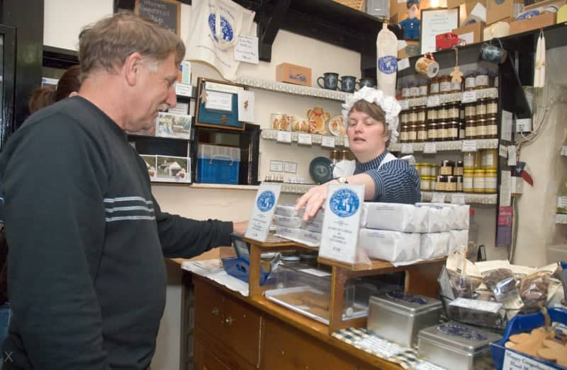Customer buying gingerbread in the Grasmere Gingerbread Shop