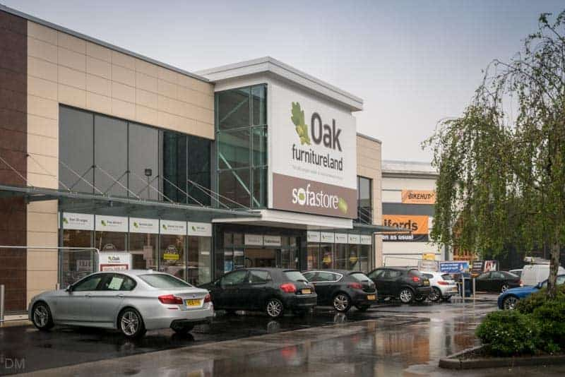 Oak Furnitureland and Halfords at White City Retail Park in Manchester