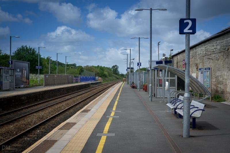 View of platforms at Blackrod Train Station showing shelters, benches, and cycle storage facilities