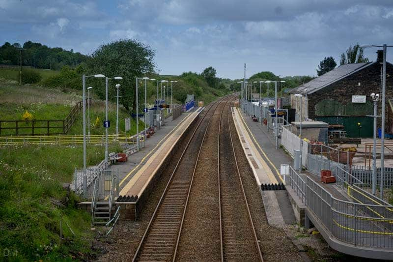 View of platforms of Blackrod Train Station from bridge on Station Road