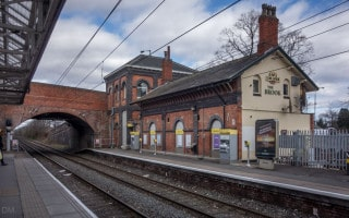 Brooklands Metrolink Station and The Brook pub