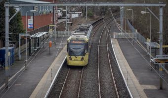 View of tram at Dane Road Metrolink Station in Sale