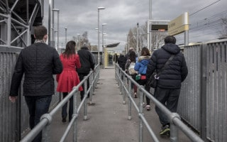 Manchester United supporters at Old Trafford Metrolink Station