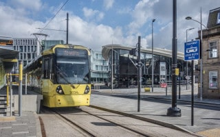 Tram to Manchester at Rochdale Town Centre Metrolink Station