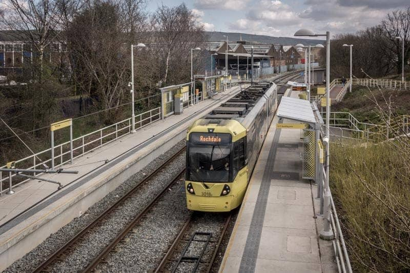 View from Elizabethan Way of a tram at Milnrow Metrolink Station