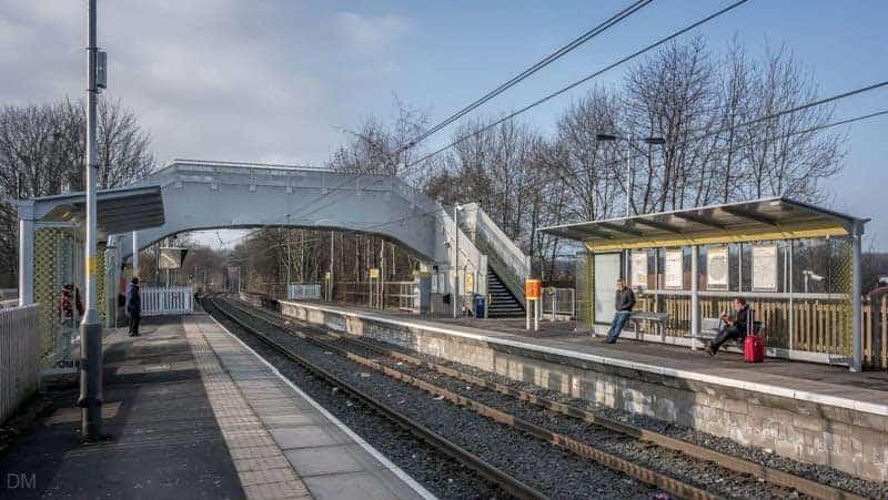 Platforms and footbridge at Bowker Vale Metrolink Station.