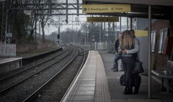 Passengers waiting on the platform for a tram at Talbot Road Metrolink Station.