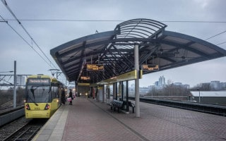 Platform at Cornbrook Metrolink Station with tram going to Manchester Airport.