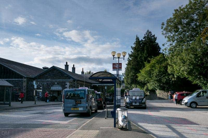 Taxi rank, car park, and entrance to Booths at Windermere Train Station