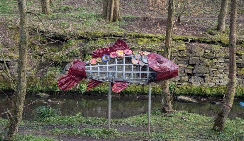 Sculpture in woods at Queens Park