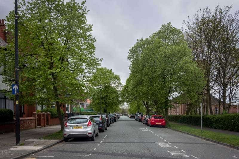 Cars parked on Mesnes Park Terrace in Wigan.