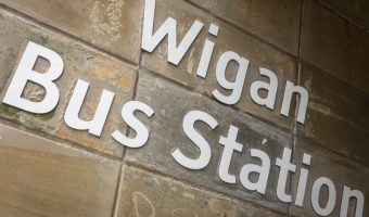 Sign for Wigan Bus Station on Market Street in Wigan.