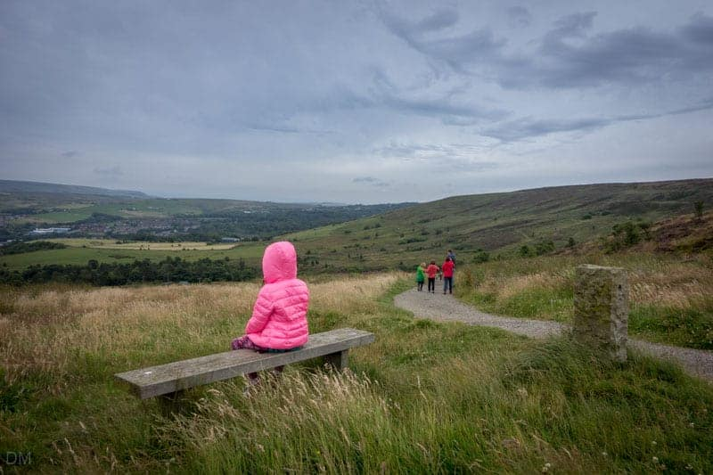 Girl sitting on a bench near Darwen Tower, Lancashire