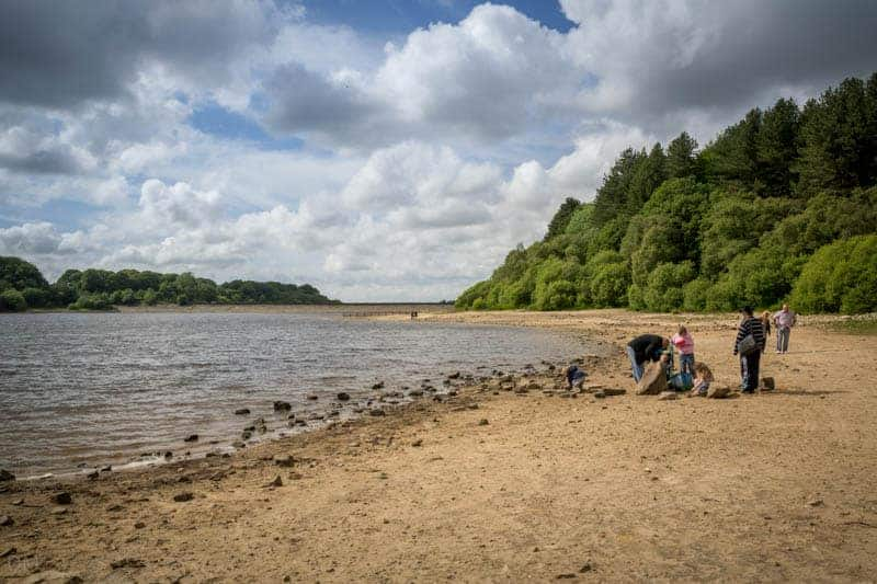 Family on shoreline at Lower Rivington Reservoir, near Bolton and Chorley