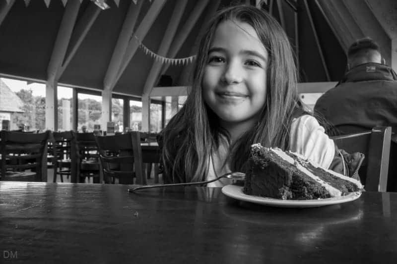 Girl eating a cake at the Restaurant, Brockholes nature reserve