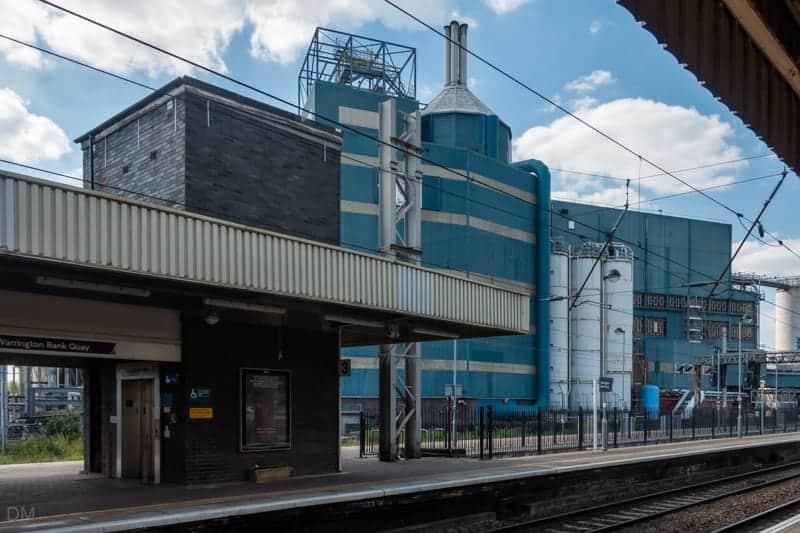 Station platform and Uniliver factory at Warrington Bank Quay Train Station