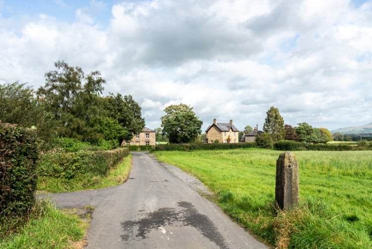 Approaching houses at Woodfields, Knowles Brow
