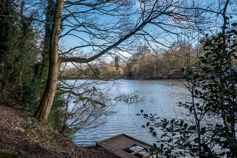 View of the lake at Lymm Dam and St Mary's Church