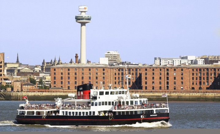View of a ferry passing Albert Dock in Liverpool