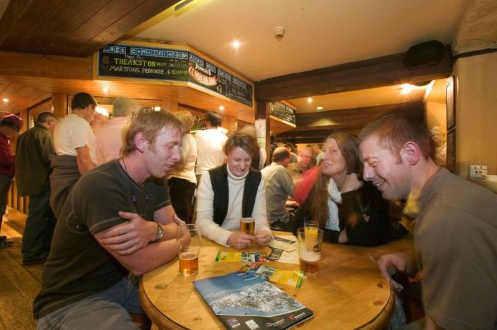 People drinking in Vats Bar at the Brewery Arts Centre, Kendal, Cumbria