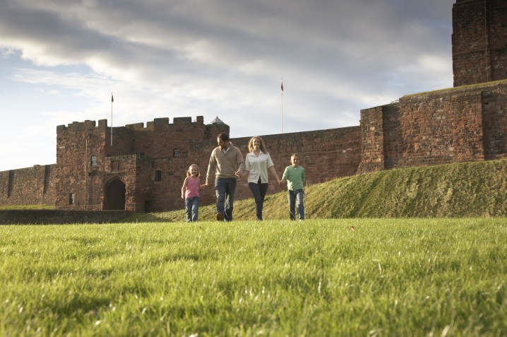 Family walking outside Carlisle Castle in Cumbria
