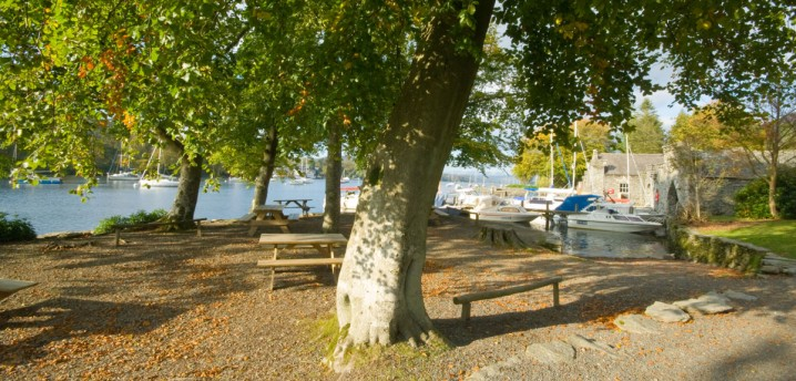 View of a picnic area and boats at Fell Foot Country Park, Windermere