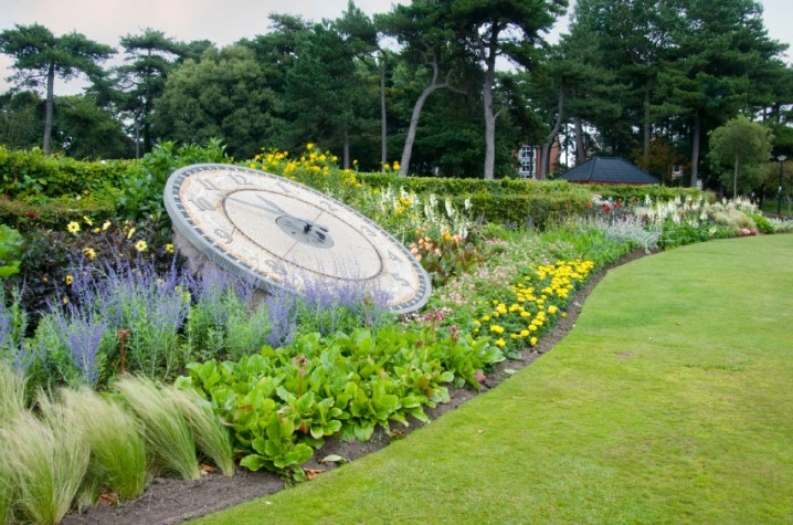 Flower bed and clock in Lowther Gardens in Lytham, Lancashire