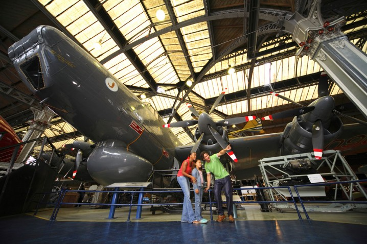 Family looking at aircraft inside the Air & Space Hall at the Museum of Science and Industry in Manchester
