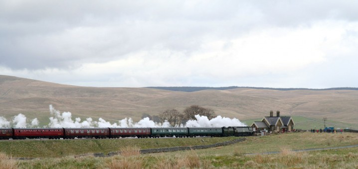 Steam train passing Ribblehead Station