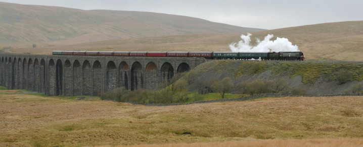 Steam train crossing the Ribblehead Viaduct on the Settle to Carlisle Railway